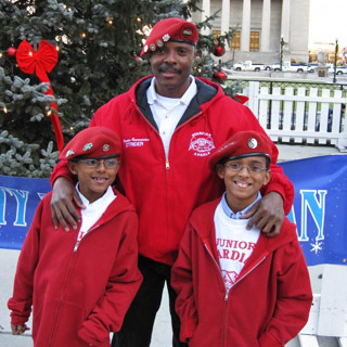 "Photo of Marcus ""Strider"" Dent with two Junior Angels"